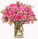 Pink roses and mix flowers in a Vase:  same day delivery available