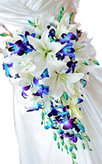 Brides bouquet made of White Liliums, blue orchids  available for Chennai.