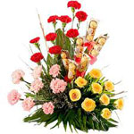 Send New Year Gifts with Exotic Flowers Arrangementwith Carnation and Ferrero Rocher Chocolates.