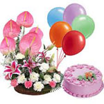 Send New Year Gifts with Mixed Flowers Basket with 5 Balloons and 1 Kg Strawberry cake