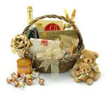 Send New Year Gift Basket contains Onw Louxton Australian Champagne 750 ml Plum cake, Ferrero Rocher Chocolates , Lindt Chocolate, Assorted Cookies, Jam, Sugar Coated Almonds, Walkers,  Royal Danish Cookie, cracker, wafer, Biscotto, Seasame and Sinckers Chocolate and Twin Teddy Bear.
