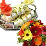 Send New Year Gifts with 1 Kg Kaju sweets and a Mixed Flower Bouquet