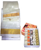 Send Pongal Gifts with Pattu Veshti with 1 Kg Assorted Sweets to Chennai Delivery.